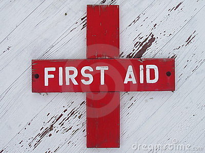 Weathered First Aid Sign