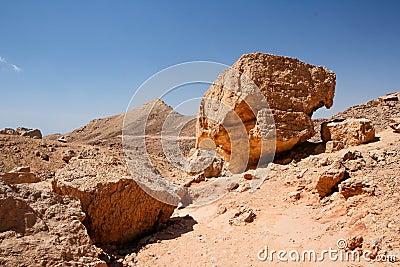 Weathered orange rocks in desert