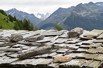 Weathered shingle roof in Italy