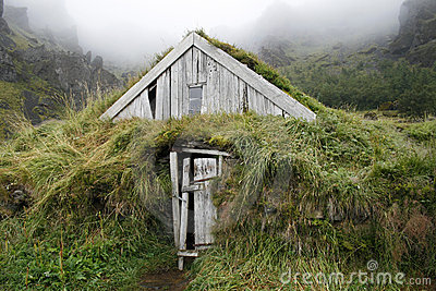 Weathered turf house