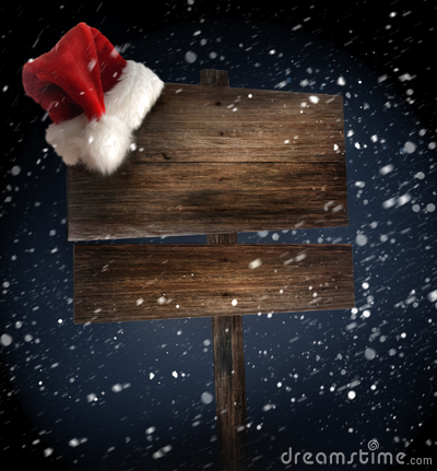 Free Weathered Wooden Sign With Santa Hat In Snow Royalty Free Stock Photography - 16733207