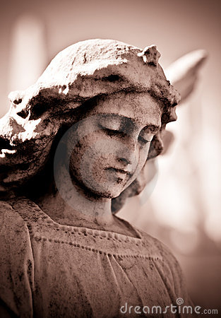 Weathered young angel in sepia