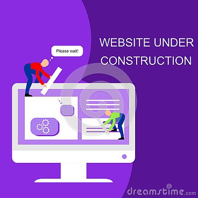 Free Website Under Construction. Two Of Young Professionals Working On A Web Page. Web Development. Stock Images - 137727634