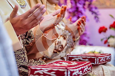 Wedded couple s hands praying