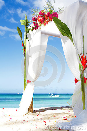 Wedding arch with flowers on beach