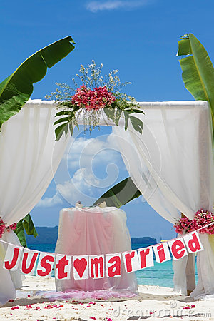 Wedding arch and set up with flowers on beach