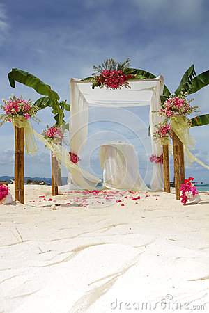Wedding arch and set up with flowers on tropical beach