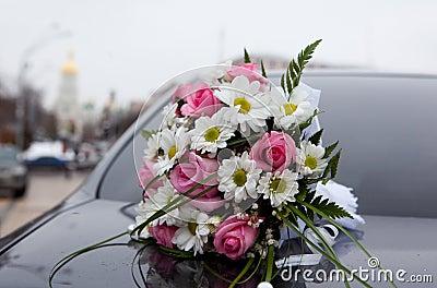 Wedding bouquet, background a church