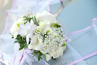 Wedding bouquet on banch. White flowers on blue background