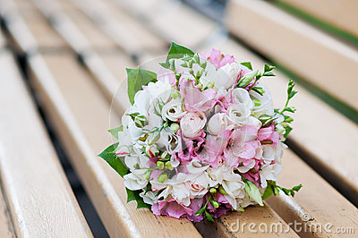 Wedding bouquet on banch. White and pink flowers