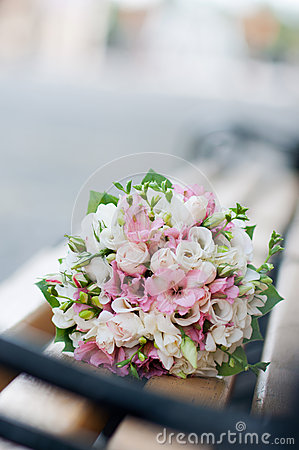 Wedding bouquet on banch. White and pink flowers. Marriage