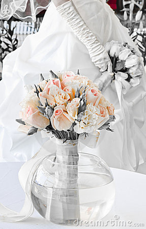 Wedding bouquet with bride in the background