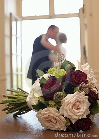 Wedding Bouquet With Bride And Groom