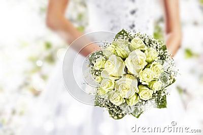 Wedding bouquet at bride s hands