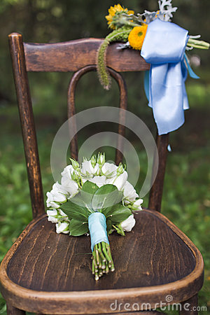 Wedding bouquet on the chair
