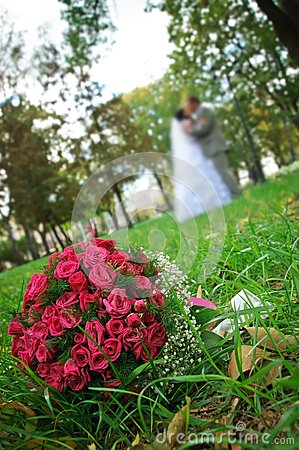 Wedding bouquet lying on a green grass
