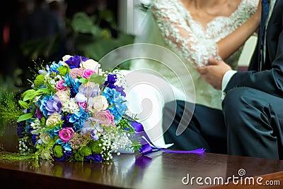 Wedding bouquet near bride and groom