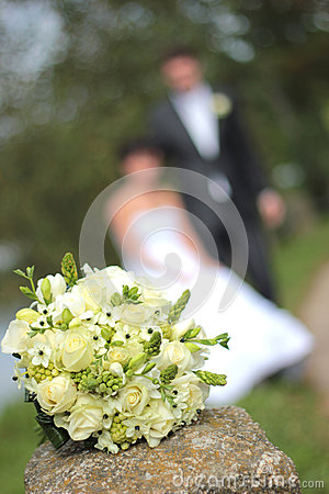 Wedding bouquet and newly married couple