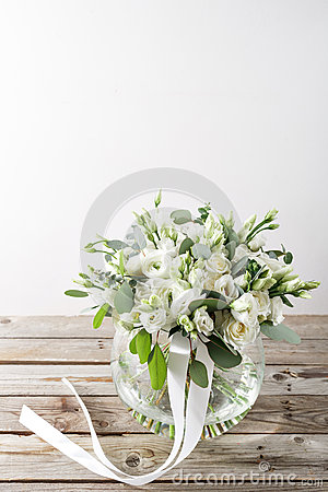 Free Wedding Bouquet Of White Roses And Buttercups On A Wooden Table. Old Rustic Background Stock Photo - 87351340