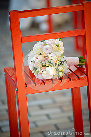 Wedding bouquet on a red chair