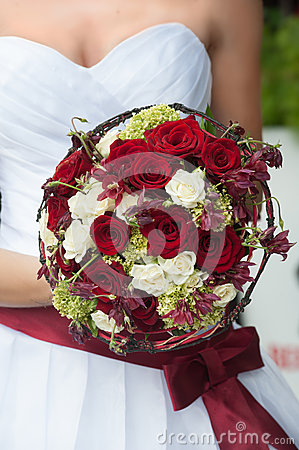 Wedding bouquet with red and white roses