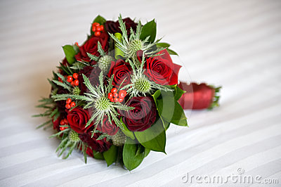 Wedding bouquet of roses and eryngium