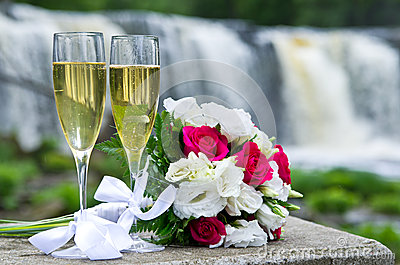 Wedding bouquet and sparkling wine