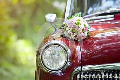 Wedding bouquet on vintage wedding car