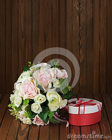 Wedding bouquet from white and pink roses on wooden background.