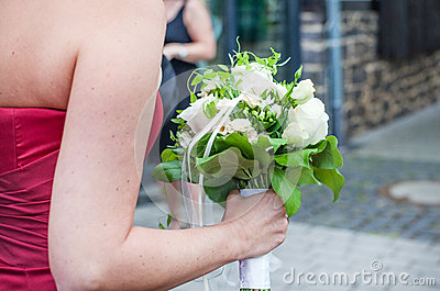 Wedding bouquet of white roses and white flowers