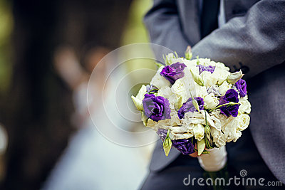 Wedding bouquet of white and violet flowers