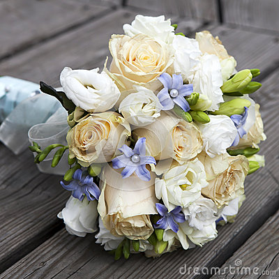 Wedding bouquet of yellow and white  roses