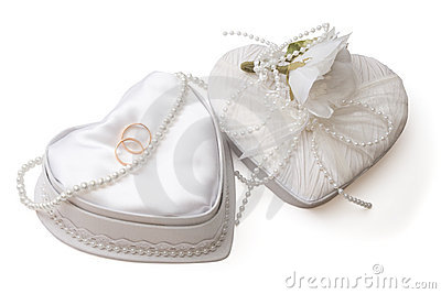 Wedding box with rings and pearl beads, isolated