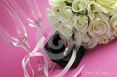 Wedding bridal bouquet of white roses on pink background