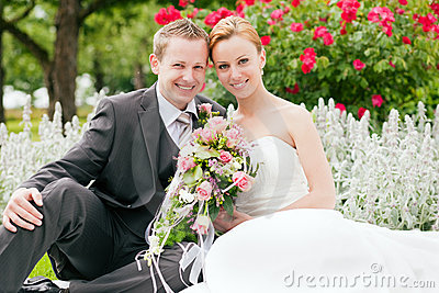 Wedding - bride and groom in a park