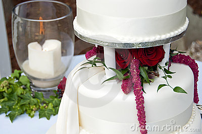 Wedding cake and remembrance candle