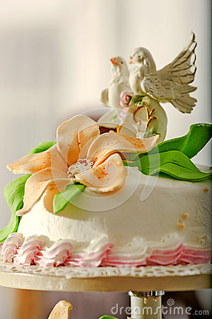 Wedding Cake On A Support With Doves On Top