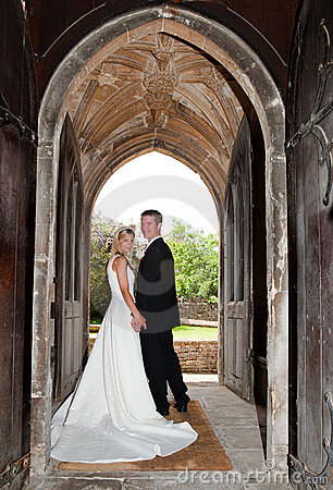 Wedding couple in church entrance
