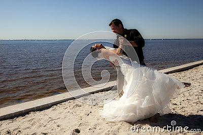 Wedding couple dancing on beach