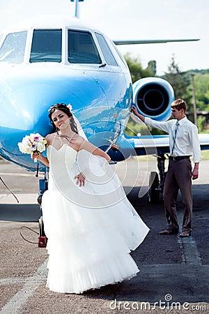 Wedding couple fly on honeymoon Stock Photo
