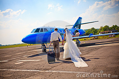 Wedding couple fly on honeymoon