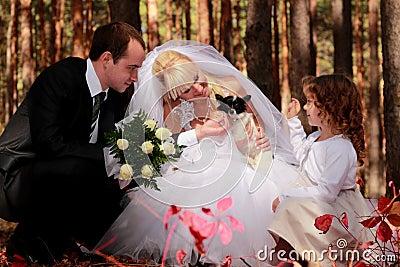 Wedding couple, girl and little dog outdoor