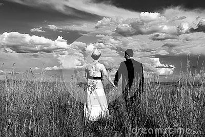Wedding Couple Holding Hands While Walking Stock Photo ...