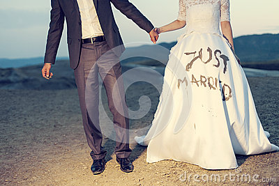 Wedding couple holding on trash the dress with dirty dress
