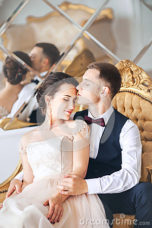 Free Wedding Couple On The Studio. Wedding Day. Happy Young Bride And Groom On Their Wedding Day. Wedding Couple - New Family. Stock Images - 92116184