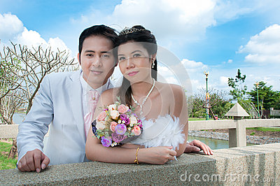 Wedding couple in the park in thailand