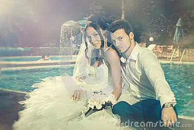 Wedding couple at pool