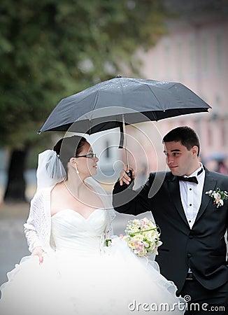Wedding couple in rain