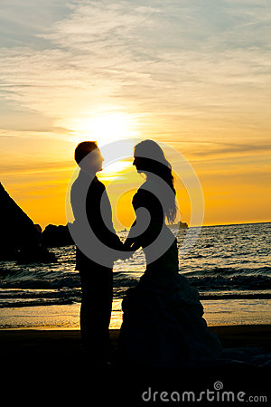 Wedding Couple Silhouette On The Beach Holding Hands