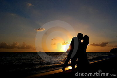 Wedding Couple silhouette on the beach at Sunset